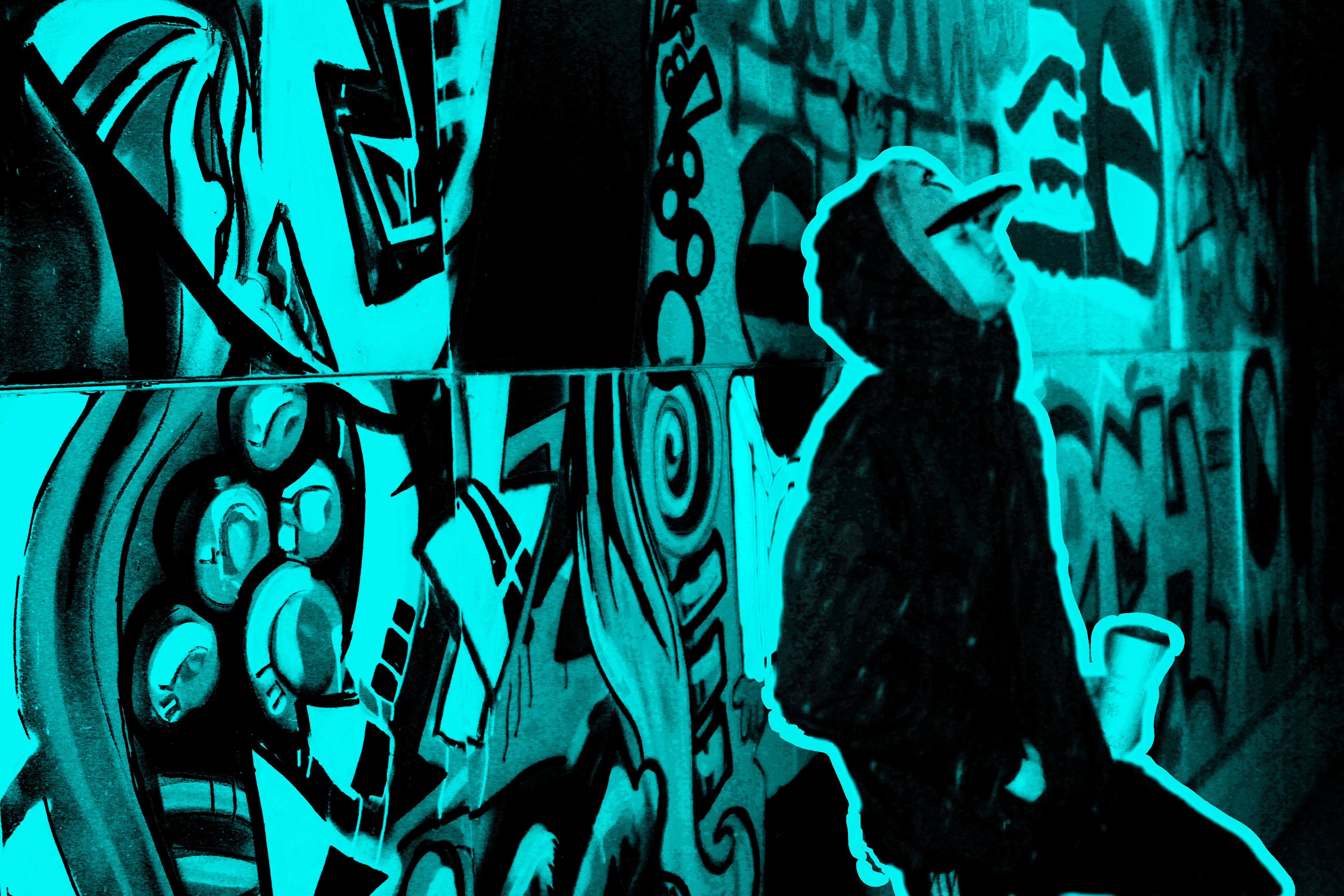 aidge standing against a graffiti wall