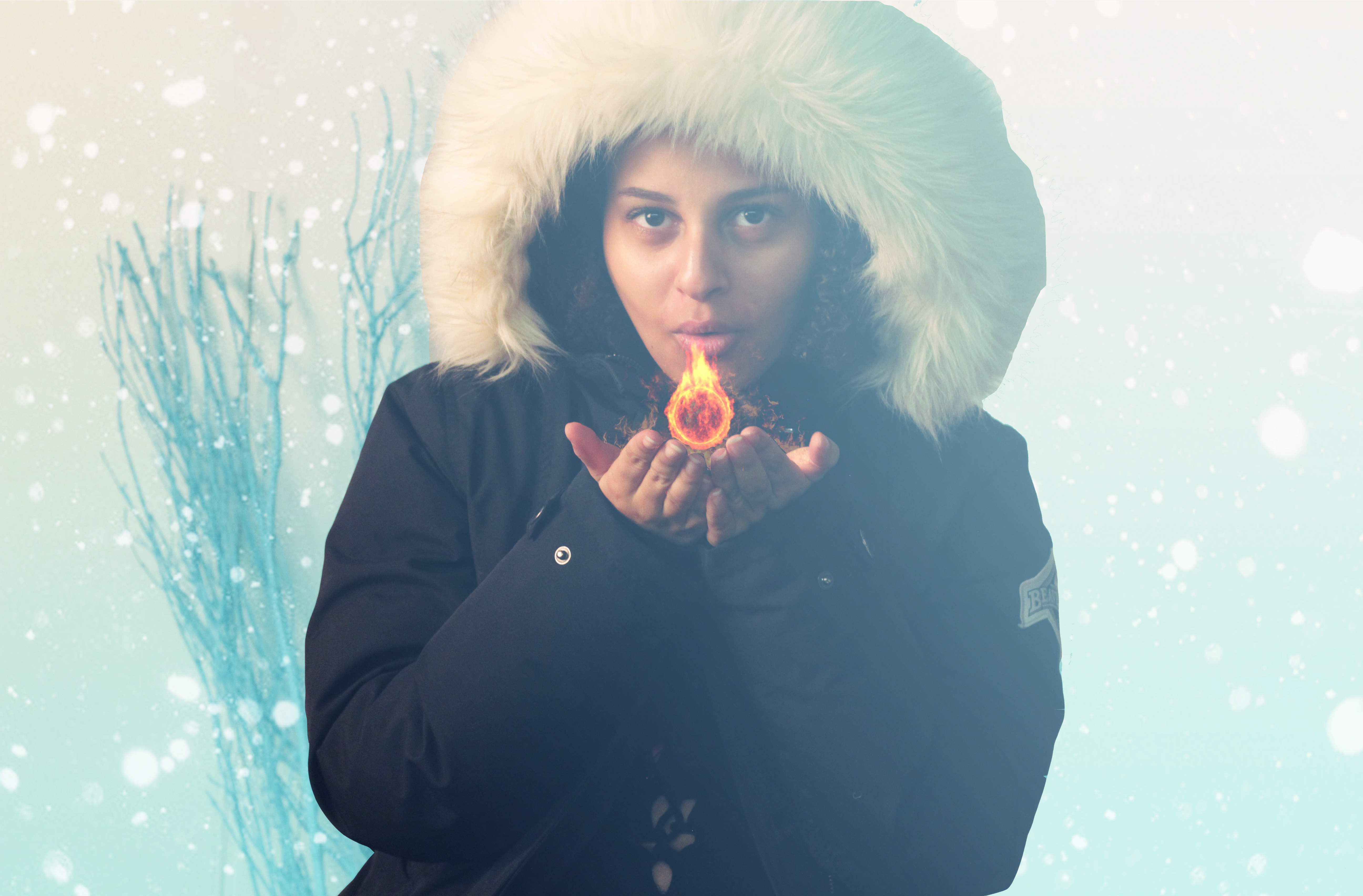 hooded girl in the snow with flame