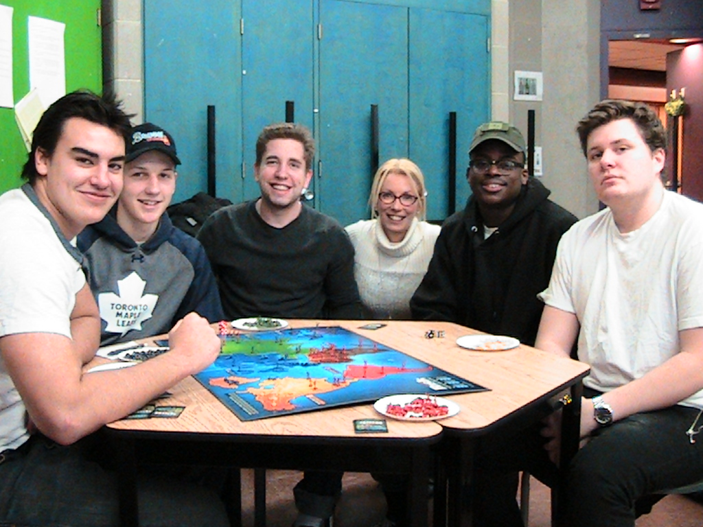 students and kim playing risk