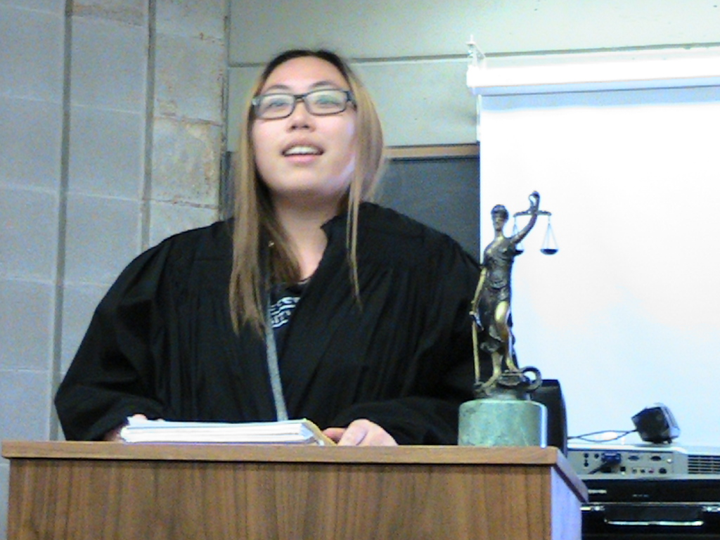 student in a judge's gown