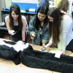 students examining body