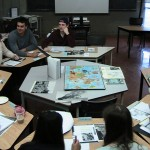 students sitting around a map of the world