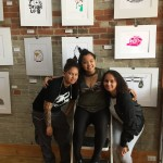 students smiling in front of pics