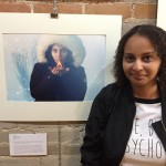 f posing in front of a picture of herself