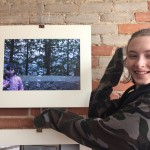 c posing with her photo